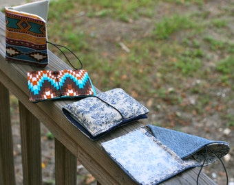 Pocket Wallet women's or men's with elastic strap of various colors and designs.