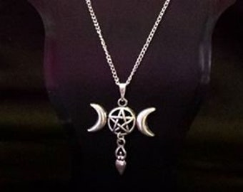 Fine silver plated curb chain necklace with triple moon pentacle and goddess charms. Wiccan, Witch and Pagan inspired.