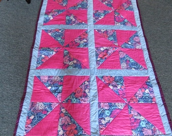 Quilt, pinks and blues, pinwheel style. 48x74