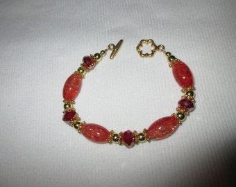 Ritzy orange sparkly bracelet