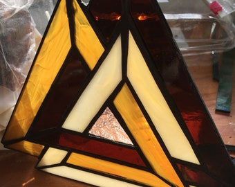 3 triangles in stained glass interlocking in bronze gold and wispy tan colors