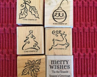 Six wooden rubber Christmas stamps by Stamping Up! A compiled set, used, merry wishes, reindeer, ornament, holly, tree, poinsettia