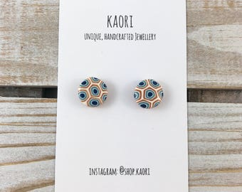 Handcrafted polymer clay stud earrings in white, blue and copper spots and dots