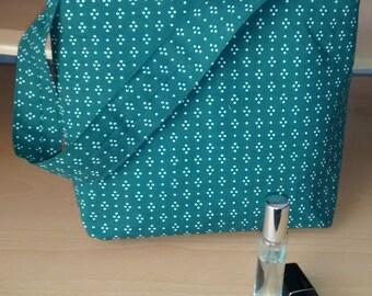 Spotty green fabric handbag