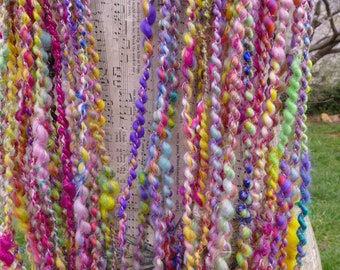 Hand Spun Core Spun Art Yarn From Hand Made Batt And Plyed With Tiny Pink Bead Thread 47 Yards