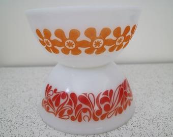 pair of vintage pyrex mixing bowls