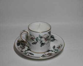 Lemon scented candle in vintage china cup and saucer