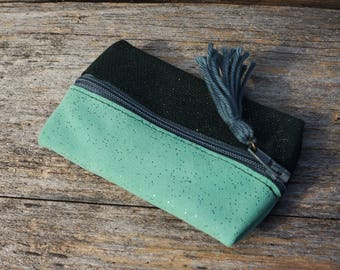 The two-tone green leather wallet with elegant gray pompom