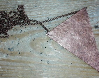 Long necklace with hammered copper central