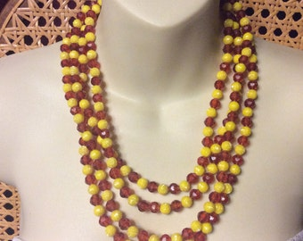 Amber and yellow colored faceted beads flapper necklace. 88 inches.