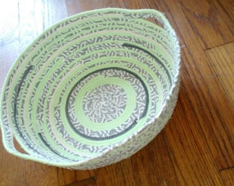 Green, white, and grey basket