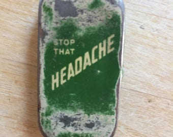 "Tiny Tin with ""Stop that Headache"" on it."