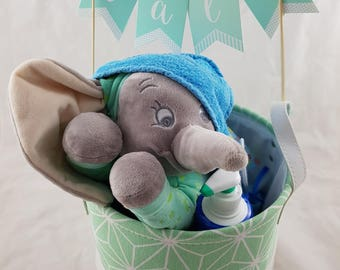 A baby elephant is hidden in the laundry basket!