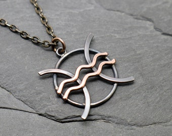 Pisces Aquarius zodiac necklace in oxidised and polished copper