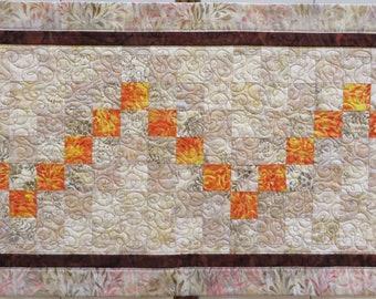 Quilted Batik Table Runner creams brown orange