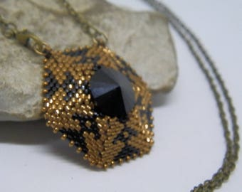 Woven black and bronze needle necklace