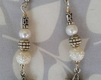 Pretty beach-themed pearl drop earrings with starfish charms