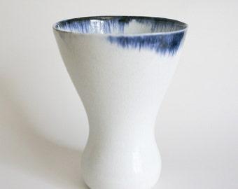 White porcelain vase with blue rim
