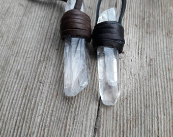 Leather wrapped clear quartz, leather wrapped pendant, quartz, trippy serendipity, trippyserendipity, festival jewelry, healing