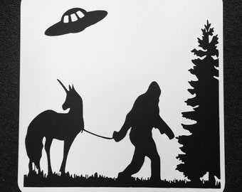 Bigfoot leading a Unicorn with  UFO Flying Nearby Forrest Setting 12 inch by 12 inch Metal Sign. Finding Bigfoot, Unicorn, UFO, Unexplained