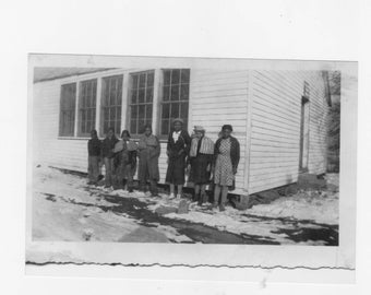 1930s  photograph of a group African Americans standing by a one room school house a reprint from original photograph