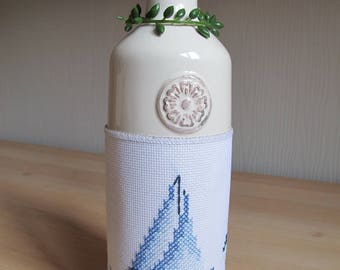 Pot or decorative vase with embroidered band