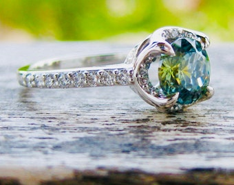 Unheated Blue Green Montana Sapphire Engagement Ring in Platinum with Diamonds and Scroll Details on Basket Size 5