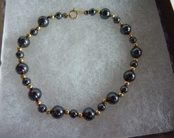 "14k Gold and Black Hematite Bracelet 7 1/2"""