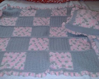 Heart baby blanket with matching pillow.
