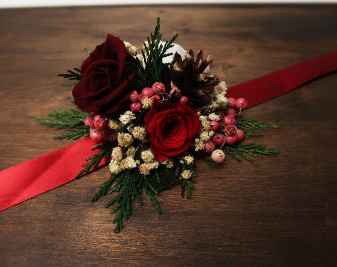 Winter wedding wrist corsage in red, white and burgundy