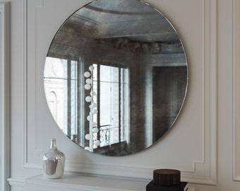 Antiqued wall mirror.  Antiqued glass mirror. Custom antiqued glass mirror. Round, frameless hanging wall mirror.