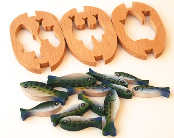 Wooden Boat puzzle containing 12 painted fish.