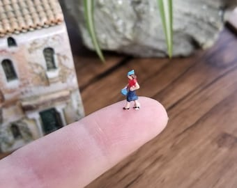 small micro miniature plastic lady figure diorama or glass ball terrarium or miniature dome jewelry glass ball filler