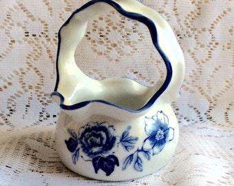 Vintage flow blue prcelain ribbed handle basket.