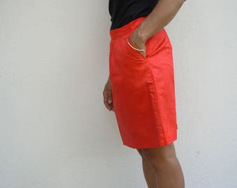 NGOR has style. The original Dyolof too with this red damask skirt