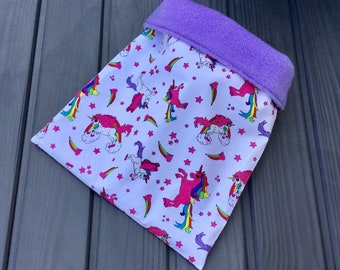 Unicorns polycotton and fleece cuddle sack for small pets. Available in a range of fleece colours.