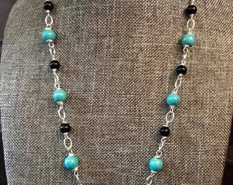 Turquoise spike necklace with turquoise colored howlite and black agate beads