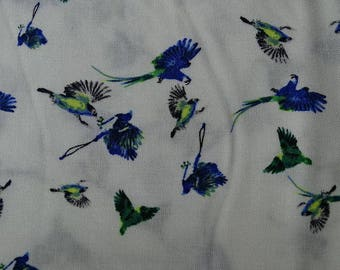 Green and blue with white birds printed viscose fabric