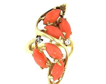 A 14K yellow gold Coral And Diamonds Ring
