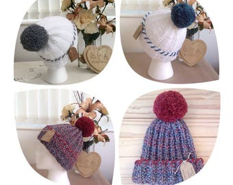 Handknit  Ribbed Beanie Hat with coordinating yarn Pompom and stitch detail.Ready to ship
