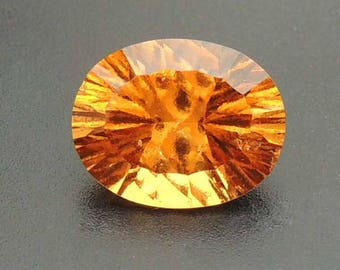 Concave cut Hessonite Garnet