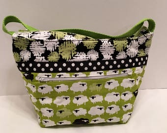 "LIP24- Lunch Bag: ""Baaa Humbug"" washable insulated lunch bag with zippered front pocket and zippered top closure."
