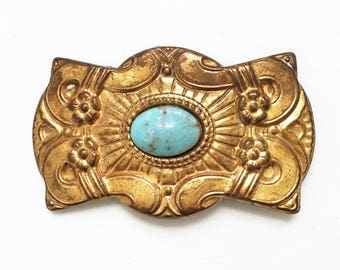 vintage tarnished decorative gold tone metal stamping art nouveau sash brooch with blue rhinestone