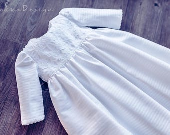 beautiful christening dress with long sleeves and delicate guipure in white colour