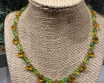 Green and gold tear drop glass beads