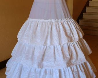 Three hoops and four ruffled crinoline petticoat.