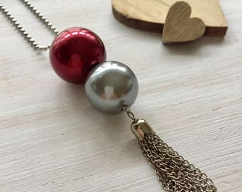 Necklace with pendant and tassel