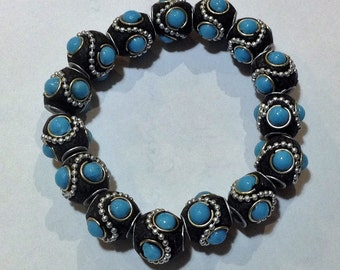 Bracelet 19cm Features High Quality Kashmiri beads. Black/blue with silver Plated trimming throughout