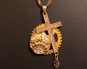 Recycled steam punk golden cross necklace on a golden stainless steel chain
