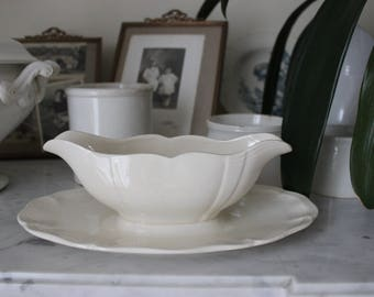 Antique gravy boat in earthenware of Sarreguemines white breakage